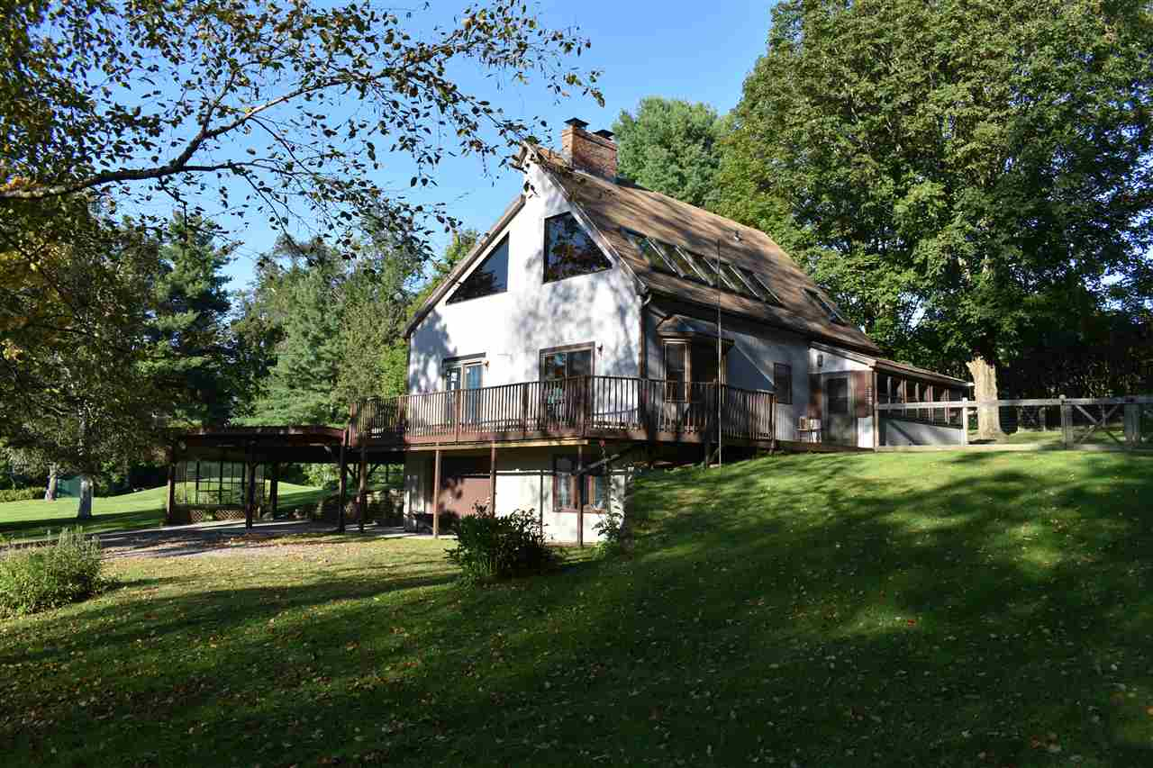 "Prime location and this is an investment opportunity that works financially whether you are an owner occupant or strictly renting all the units out.  The farmhouse (c. 1810) has been updated and renovated into 3 one-bedroom apartments. Two on the first floor and one on the second floor. Shared heating system, separate electric. Huge front porch, nice back yard, comfortable apartments. The ""shop"" building includes a garage/workshop in the center and a one-bedroom apartment and a 3 room office.  The ""Farmhouse"" building and the ""shop"" building share a mound system (permitted in 2011, WW-9-1493) and well and the main house has a separate system and drilled well. The main house was built in 1982. It's a passive solar design and has a nice flow. Three bedrooms (one on each floor), master on main living level, loft area overlooking the living room and an enclosed porch. Rec room in the basement, lots of storage space, two carport spaces, fenced dog yard and west facing deck - sunsets! House is currently unoccupied, but would likely rent for $1500-$1800/month."