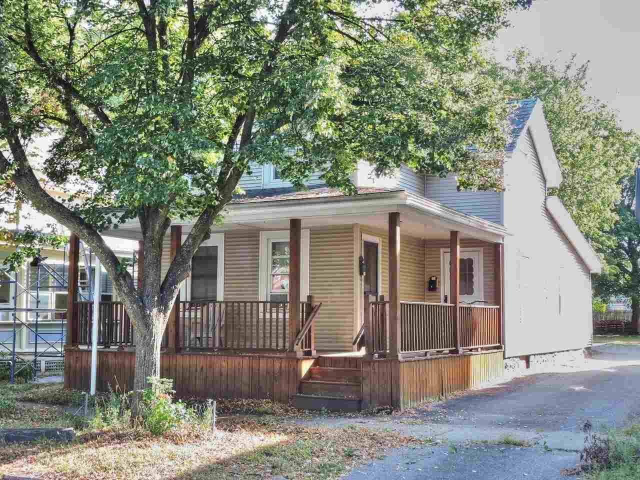 Great duplex with solid rental history on a city lot in the heart of Burlington! Well maintained property includes a large, three bedroom unit on the first floor with cheerful, spacious eat-in kitchen, living room with lots of light and a full bath. Another one bedroom unit is on the second level and includes a large kitchen, a reading nook and full bath. A full basement offers extra space for storage and a nice wrap-around deck on the front is a great entertaining spot in the summer! A deep back yard offers a secluded spot to relax and there's a shared paved driveway for off-street parking. Many new appliances and upgrades in the last few years. This is a great opportunity for investors or to owner-occupy with a sought-after location, close to Downtown shops, restaurants and services. Don't wait on this one!