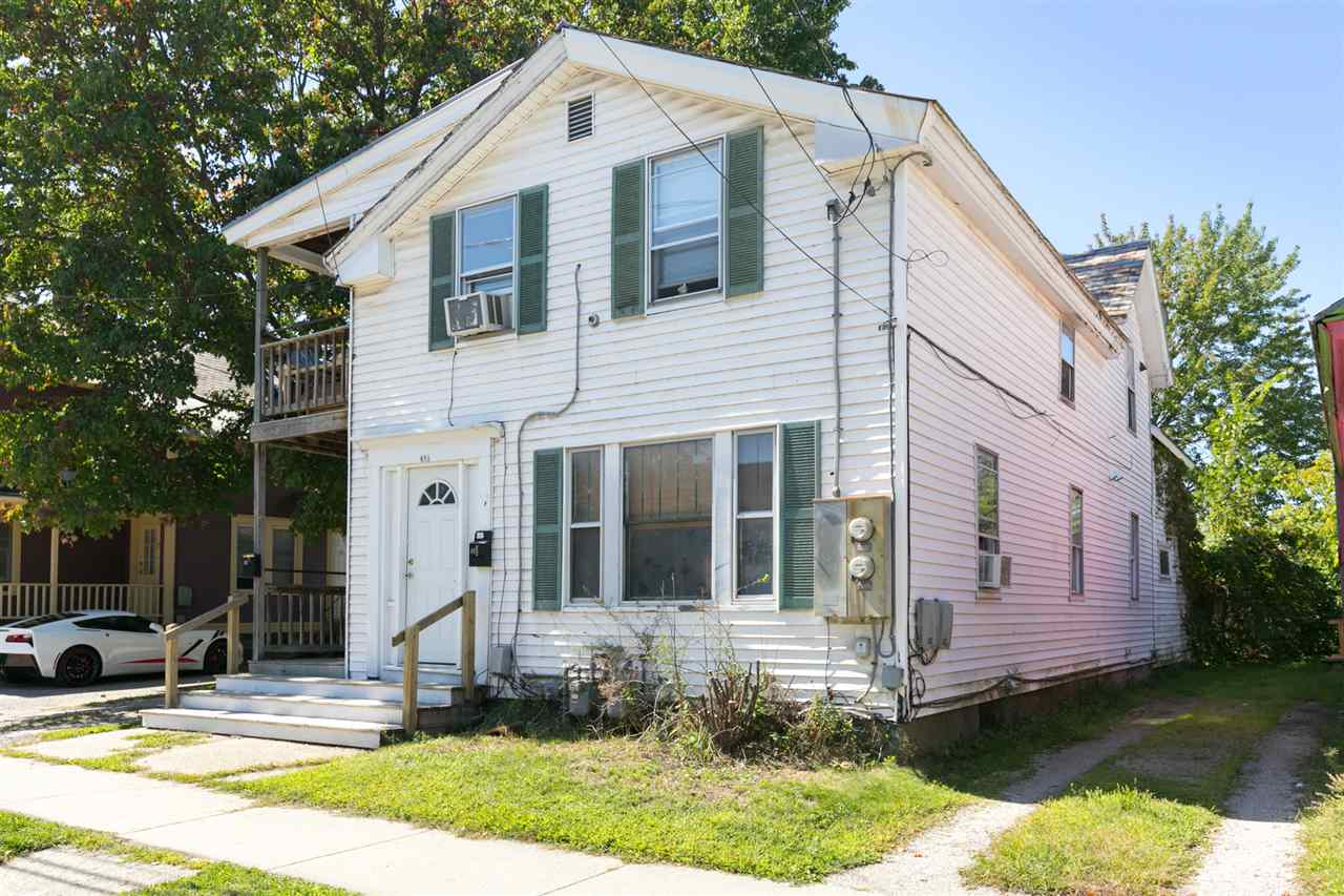 Fantastic investment opportunity or owner-occupy duplex in the heart of the Old North End. This property is close to Downtown Burlington and offers off-street parking, huge covered porches, and a large, private back yard. The three-bedroom downstairs unit includes a tastefully renovated eat-in kitchen, featuring a granite island, professional range, farmhouse sink, full-height subway tile backsplash, and cork flooring. Original wood floors run throughout the living space and the three bright & sunny bedrooms. A huge full bath includes exposed brick nogging, tile tub surround, antique vanity, and a stackable washer and dryer. The one-bedroom upstairs apartment includes an open living space, kitchen, ¾ bath with washer & dryer, and ample storage space. The living space extends to the outside with a long covered porch along the side of the building. At the back of the property, a first-floor deck overlooks a lush, fully-fenced, and private back yard. A newly built deluxe two-level shed/outbuilding offers endless possibilities as a workshop, studio, or garden/storage space, and is built to accommodate a rooftop deck or garden and south-facing solar panels. With a great location, loads of character, and a ton of upgrades, this well-maintained duplex is an absolute must-see!