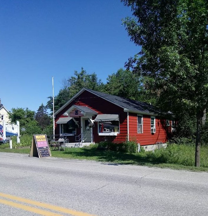 A commercial building that used to be Little Garden Market (quintessential Vermont market store/catering/take out). There is a retail area, kitchen area, storage room, utility closet, and a bathroom. Building exterior was painted in 2017. 12 permitted parking spots. Located right off a high traffic intersection of VT Route 7, 3 mi from Charlotte, VT to Essex, NY year-round ferry, major bicycle route, next to childcare center, town offices, and library.