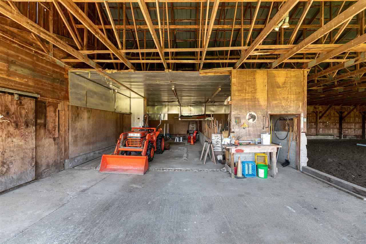 Equipment Bay, Showing Tractor, Snowblower, both Included