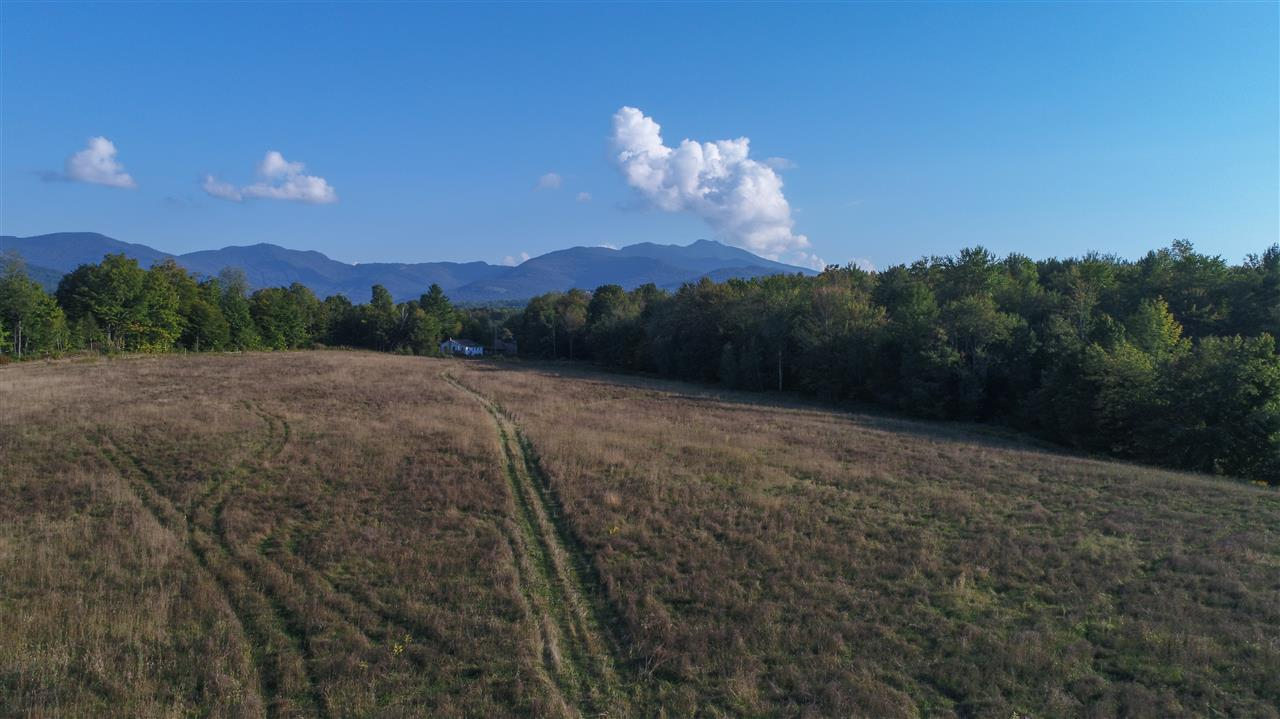 Unique opportunity! 28.38 +/- ac of open land w/views of MT. Mansfield, Smugglers' ski trails, surrounding ridgelines and sunsets. Currently an operating sand & gravel pit w/solid income stream/established local clients and reclaimed agricultural land ready to be put to work. Great potential for residential/commercial/agricultural development. Close to Villages of Jeffersonville and Smugglers' Notch Resort, minutes to Stowe in summer, over the Notch. Subject to LU permit #1100, 1100-2. No zoning, minimal subdivision regs in Cambridge.