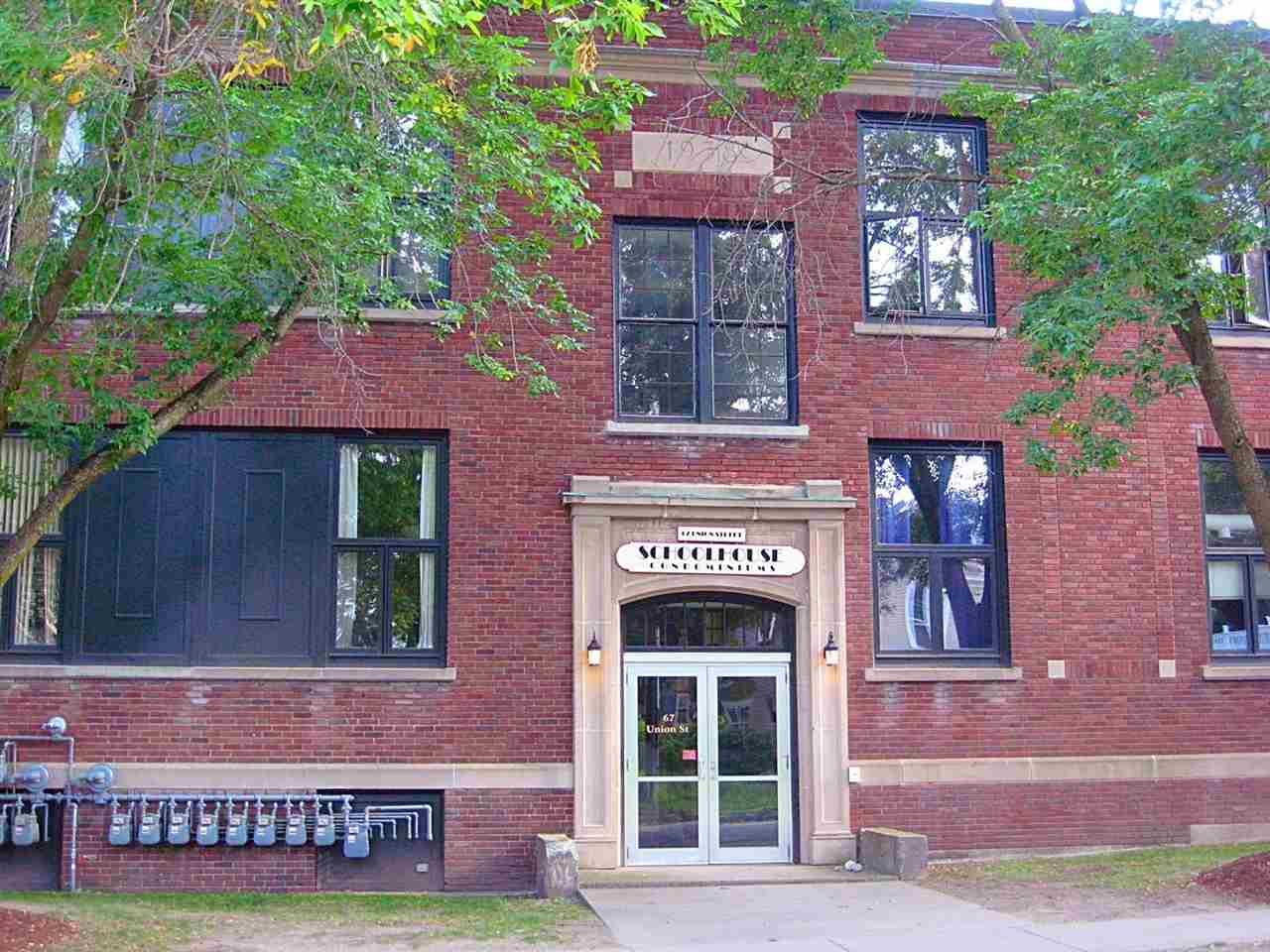 Commercial office condominium located in a former elementary school. Built in 1938, this historic school was converted into condominiums in 1990. Call for an easy showing!