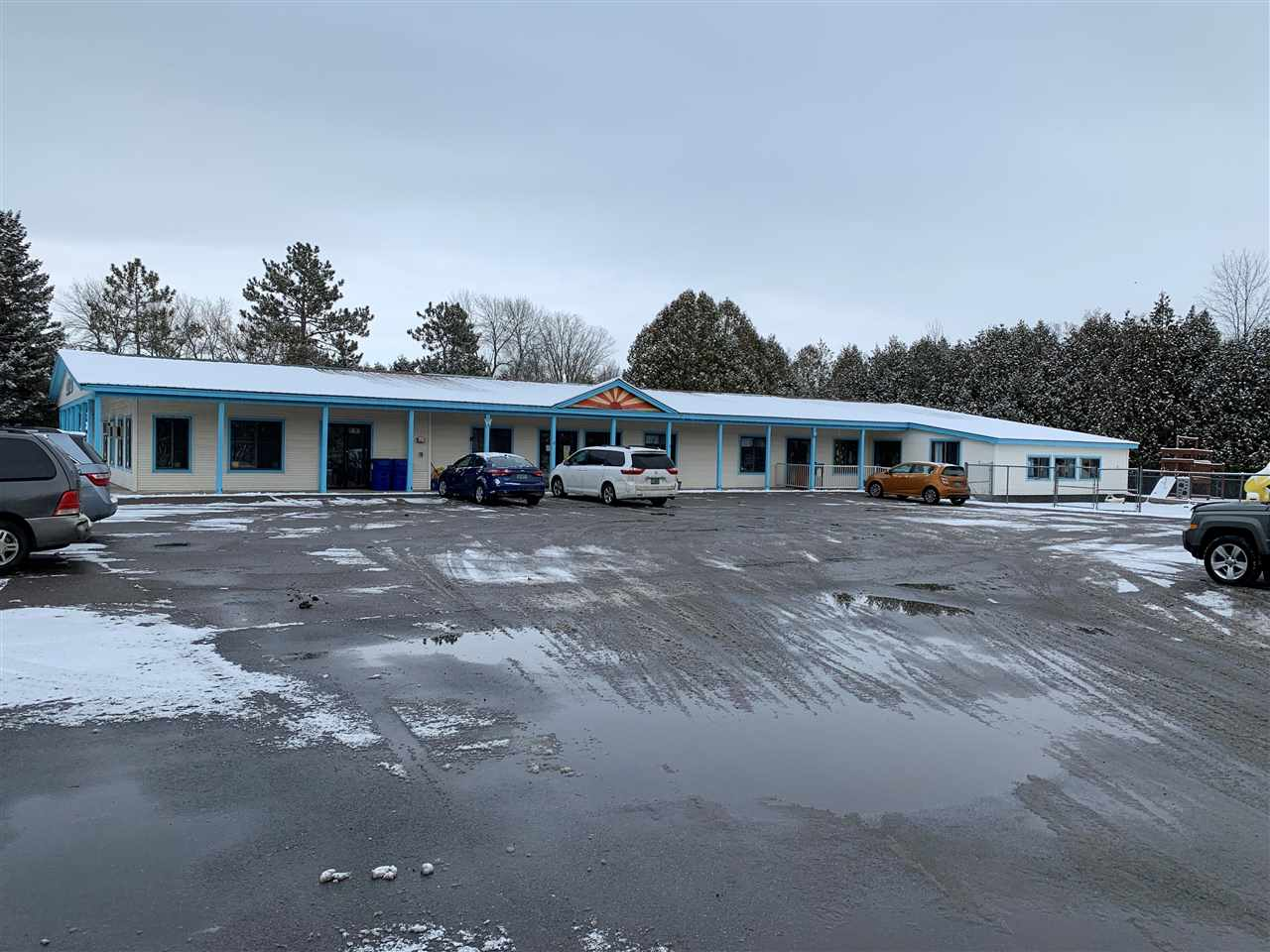 1.07 acre parcel, concrete building with just under 7000 sq ft and huge porch. Location across from new additions to Route 7 Shelburne – Rice Lumber, Healthy Living – Vibrant new area. Was strip mall now operating as a Day Care. Two kitchens and five bathrooms. Fenced area and ten exterior doors. High traffic count. Town water, town sewer, gas on site. Zoning allows for multiple commercial and residential uses. Excellent development potential.