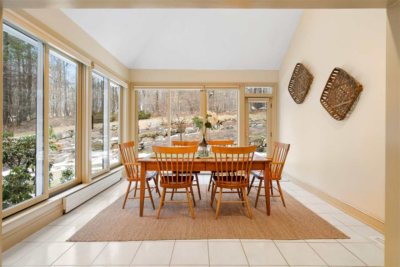 The eat in breakfast area is large and features floor to ceiling windows to let in light! 14837657