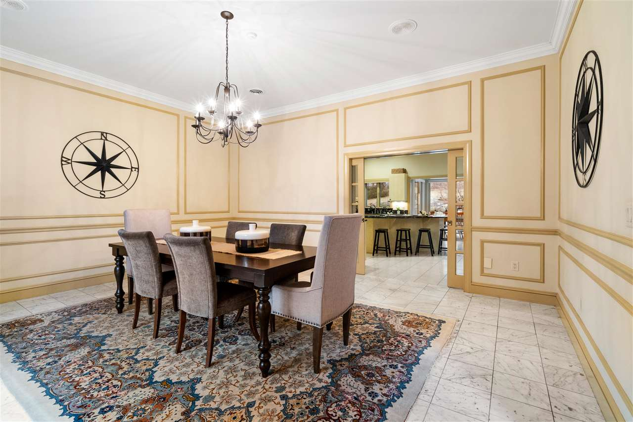 A large & beautiful formal dining room awaits your guests! 14837749