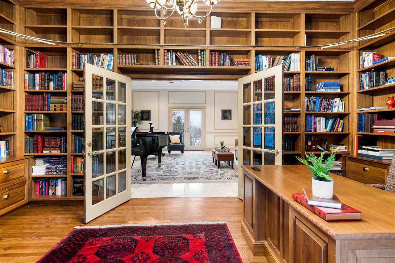 Pass through the formal living room to your own executive office & library 14837751