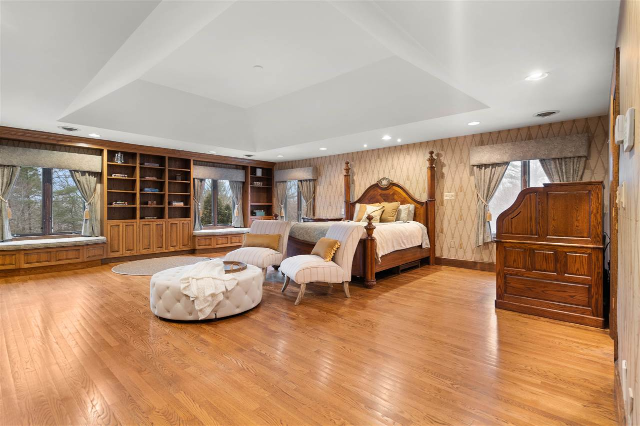 The oversized master suite is tucked away for privacy! 14837631