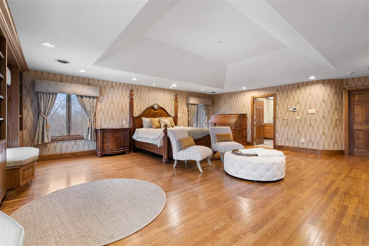 Featuring oak flooring, trey ceilings, built in