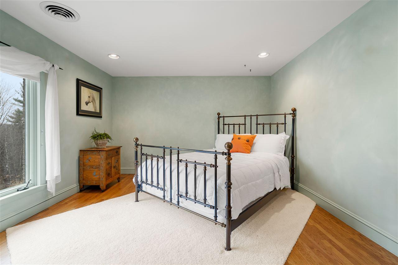 Bedroom 3 allows seasonal Lake Winnipesaukee & mountain views 14837638