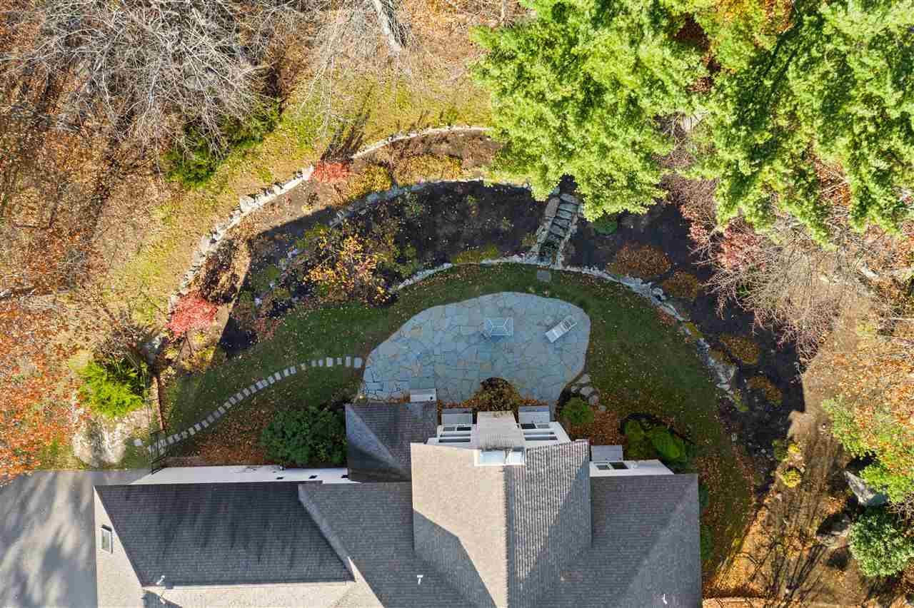 Aerial view of the backyard and custom hardscaping 14837621