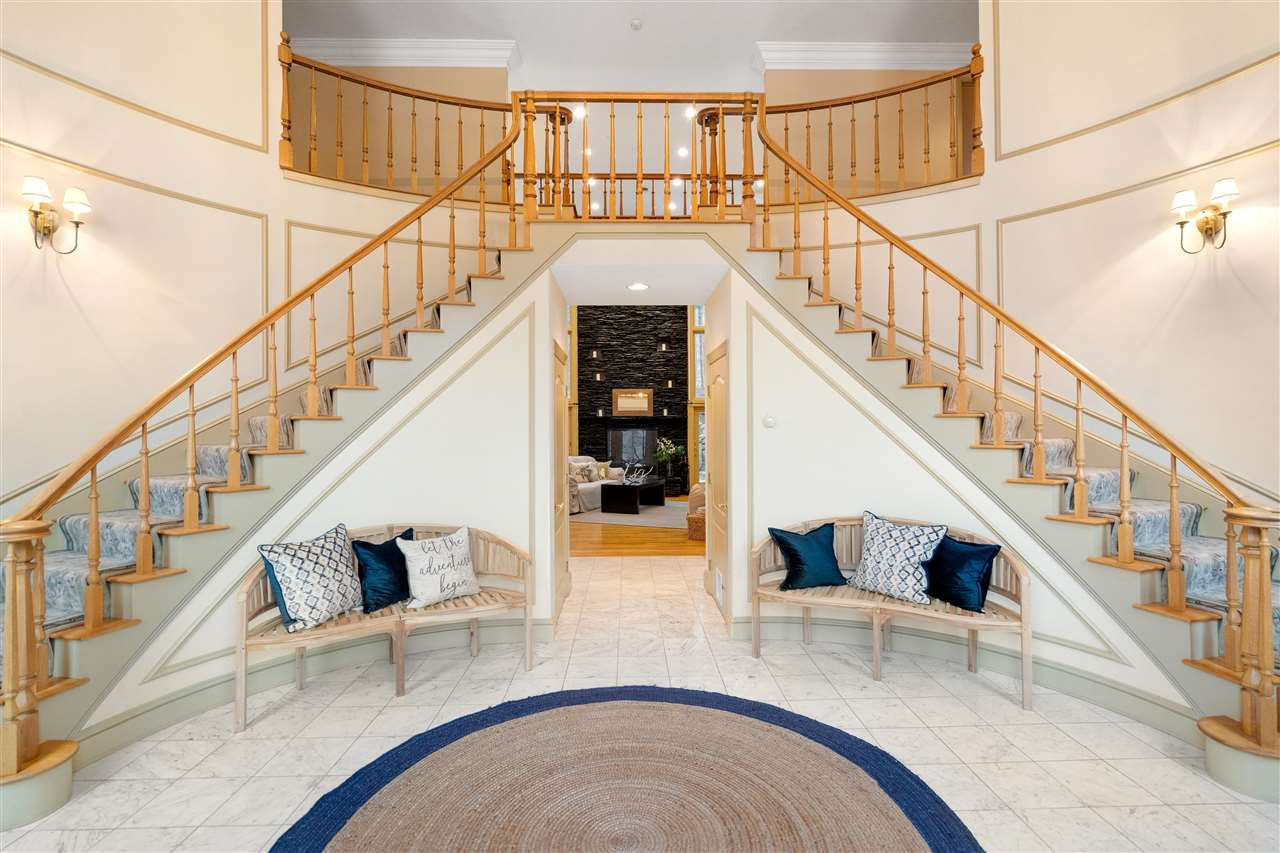 This sophisticated front foyer is a showpiece of this home! 14837651