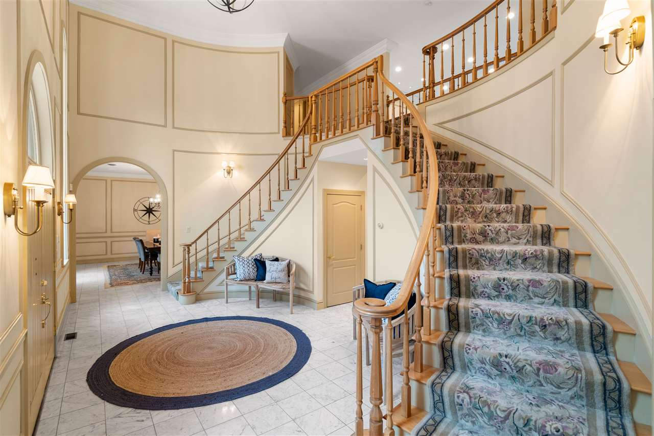 The double curved staircases are elegant! 14837652