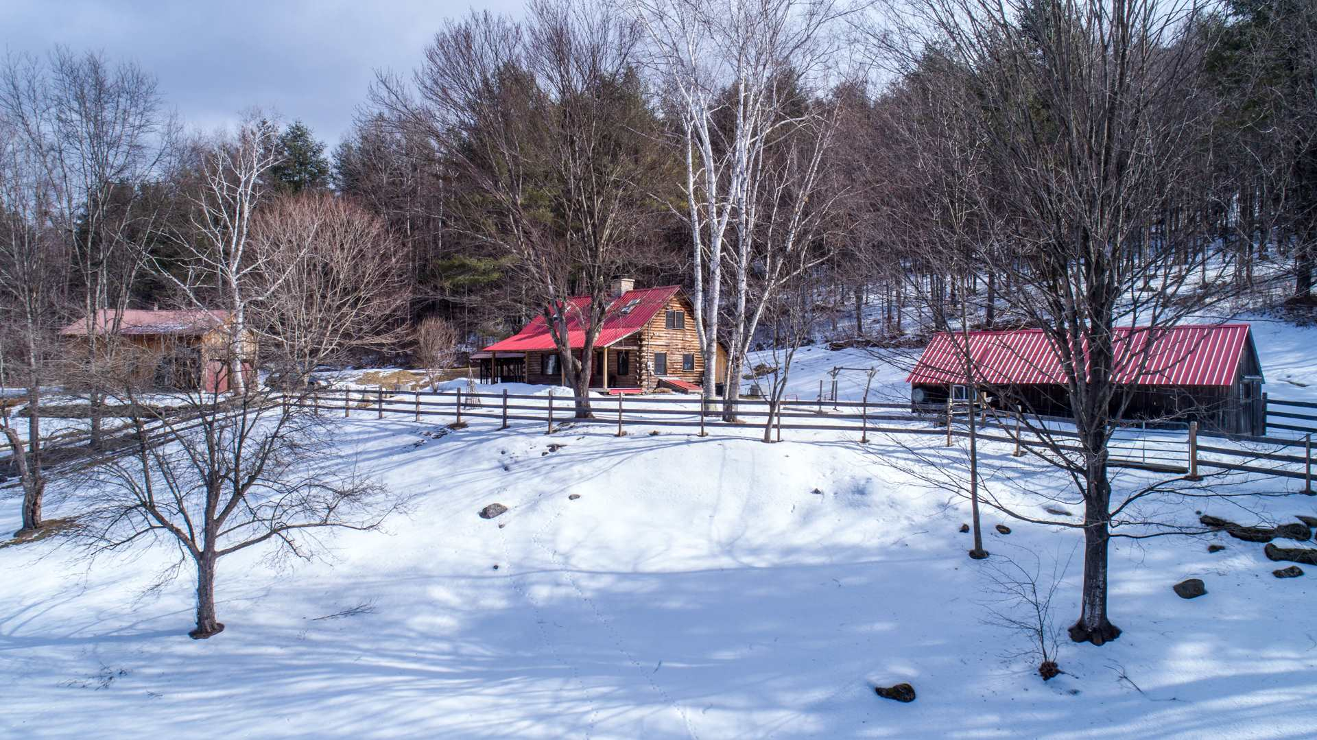Wow! Renovations throughout this very special property. Set on 6.1 beautiful acres: two stall horse barn with potting shed. Add the seperate two car garage with office, huge hay loft along with renovated log cabin and this property is perfect primary or second home. When you walk into this charming log cabin you can feel the stylish taste of the current owner. Energy efficient with; Vermont casting wood stove to warm the whole house, forced hot air heat and central air conditioning this home has it all. Three bedroom septic system, whole house generator, and fenced pasture for your horse. Located on good gravel road network, easy hack to federal land well maintained trail system. House is just a 23 minute ride up Route 106 to the GMHA (Green Mountain Horse Association) Newly blacktopped driveway makes this oasis your next home.