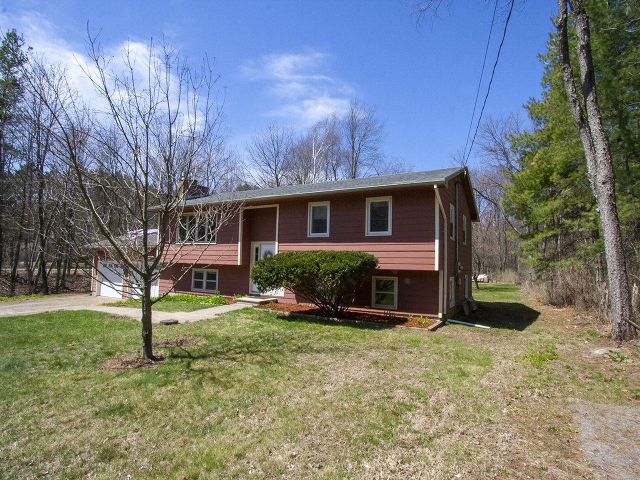 "The heavy lifting has been done with this raised ranch style duplex in ""Milchester"" (aka the convenient part of Colchester between Milton and South Hero). Off Route 2 and on your way to Niquette Bay State Park, you will find this lovely 2 acre property. Both front and back yards are huge and level, and a little seasonal stream runs the length of the property. The current owner has taken care of many important updates inside and out over the past 5 years, including a brand new roof just completed in April 2020. Full list of updates available. The upper level of the home is a warm and cozy 3-bedroom, 1-bathroom unit with a lovely enclosed porch and sunny deck. The lower level unit has 2 bedrooms and 1 bathroom, and is ready for the next owner's updates - it is a blank slate! Both have gas fireplace inserts as well as ductless mini-split units, for flexibility with heating and cooling options. Each unit has two entry points, with key-less lock systems for convenience and security. The two-car garage is currently shared between the units and offers plenty of storage. You could throw quite the summer BBQ with the number of cars you could fit in this driveway, and the lawn games you could play are endless! Cap off your evening at the fire-pit near the stream for a perfect summer day. You are literally 3 minutes to Exit 17 on Interstate 89, so your commute will be quick and convenient!"