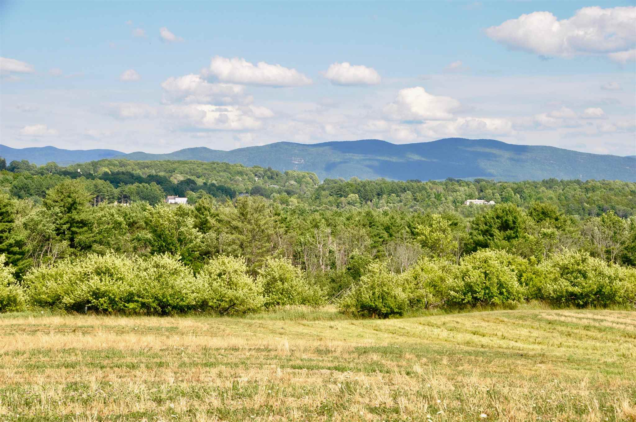 Spectacular, wide range views of the Green Mountains from this 30 acre open parcel in Cornwall. Build your dream home minutes from Middlebury College and downtown Middlebury with its restaurants, shops, theater and more. Development possibilities as well! Sitting on a rise, you look over the pastoral landscape of apple orchards and fields, with conserved land to the south. Here you will have the best of both worlds, privacy and space, but close to amenities. This is exactly what you have been waiting for.  A septic design for a four bedroom home is in the works, as is a final survey- so you will be ready to go!