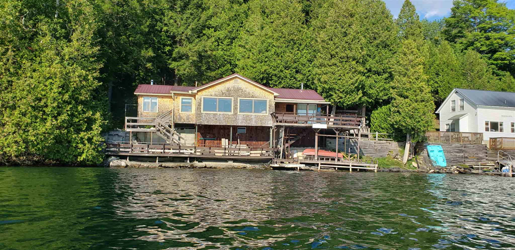 Make your summers fun! This 3 bedroom camp offers 100' of beautiful Lake front. The water is clear and deep. Huge deck overlooking the lake. Spectacular views from the dining/kitchen. Bring your boat, kayaks and kids. You will enjoy this one!
