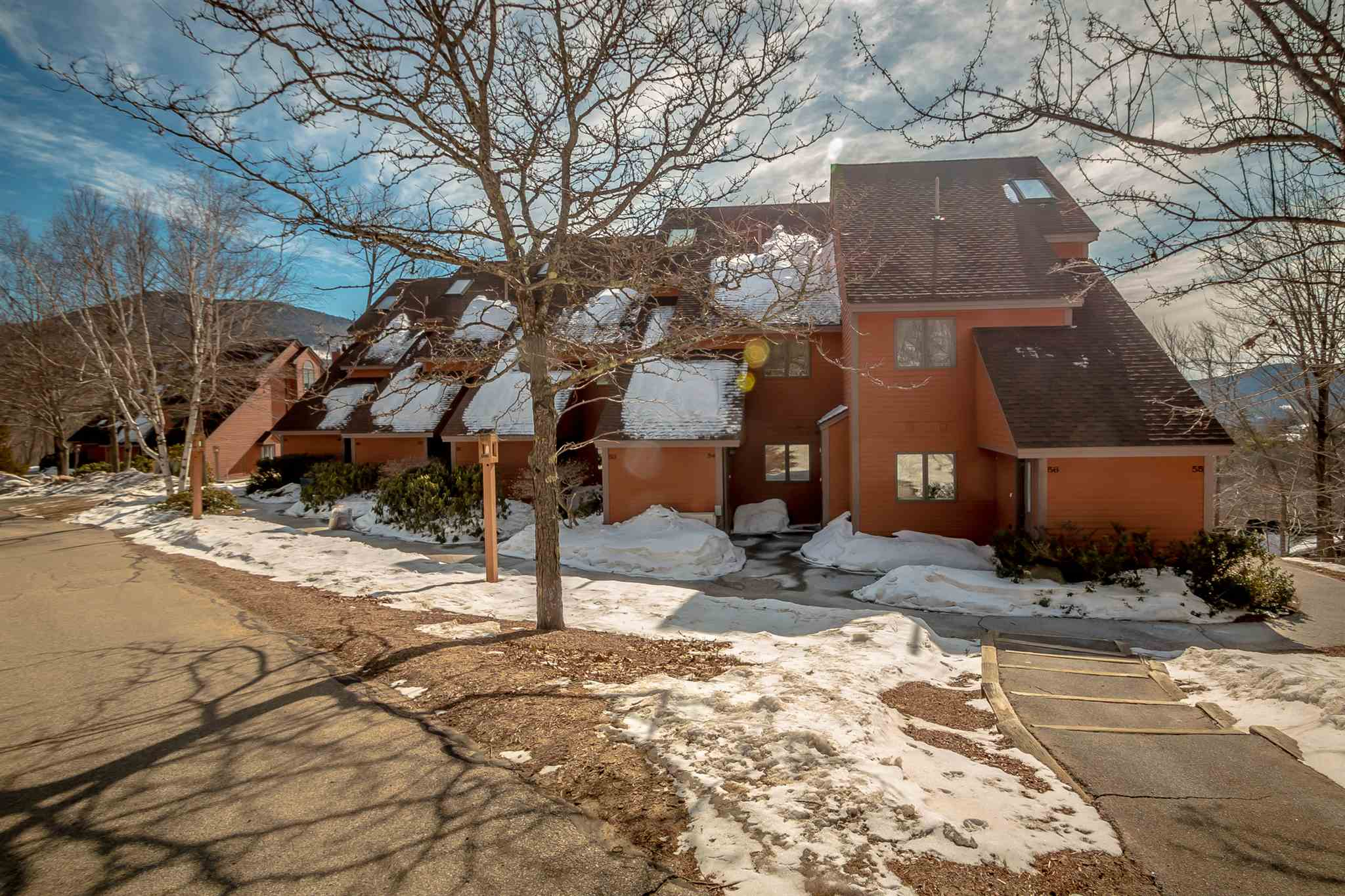 Absolute WOW factor here! Updated owner lock out unit with gas fireplaces & A/C. Gorgeous hickory flooring & granite counters are just a few of the highlights in this townhouse. The first floor has an open kitchen, living & dining area, full bath and bedroom. Great balcony off of the living room to enjoy the remarkable mountain views. The lower level has a 2nd living room that walks out onto the grounds. It has a beautiful kitchenette, gas fireplace, large bedroom and full bath with a jacuzzi tub. Enjoy both levels yourself or use one, rent the other or rent both. Nordic Village is known for its outstanding amenities & over 100 acres of landscaped grounds. Enjoy the indoor pool & jacuzzi, 2 outdoor pools & jacuzzi (heated all winter) tennis, playground, recreation room, row boating & more. The winter offers ice skating, sledding & campfires, all onsite. Attitash, Wildcat, Black Mt. all within a short drive. Downtown N. Conway only 7 miles away.